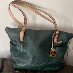 MK BAG color green H-1205 is in good condition
